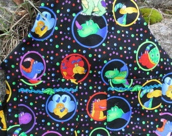 Dinosaur Preschool Black and Rainbow Colored Apron by Cover Me Aprons