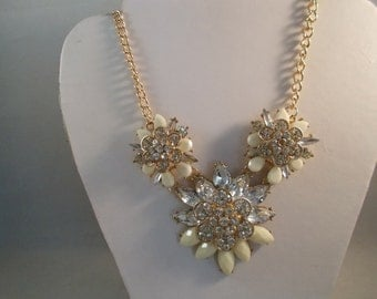 Gold Tone Chain Necklace with Ecru, Clear Crystal and Clear Rhinestone Flower Pendants