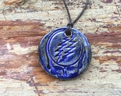 """796 Steal Your Face Pendant on adjustable 29"""" cotton cording"""