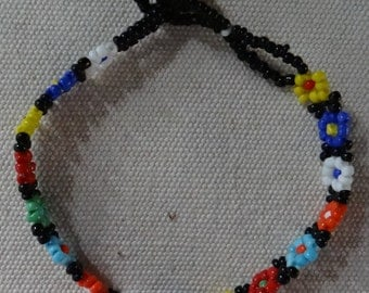 """Beaded Flower Bracelet in Red, Yellow, Blue, Orange, Pink and White with Loop and Knot Closure, 7"""" Long"""