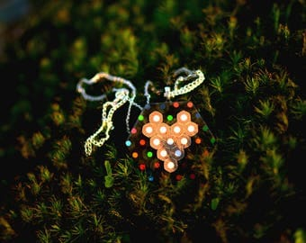 Hexagonal necklace with heart made of colored pencils