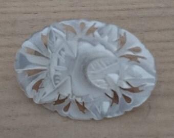 Vintage mother of pearl carved brooch