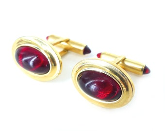 Vintage authentic old school Krementz  cufflinks in a Luster red oval with ruby red tipped hardware. Squared hardware