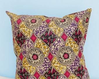 Funky pink African Java wax print scatter cushion 50x50cm: liven up your home or office with this mixed print scatter cushion