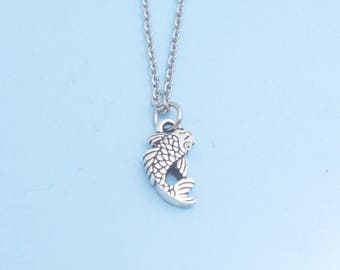 """Koi Fish Necklace in antique silver plated pewter on an 18"""" stainless steel cable chain with lobster claw clasp."""