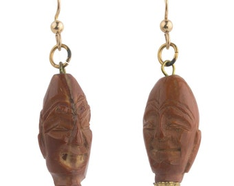 Earrings of vintage hand carved Chinese Hedeio carved fruit pits. Gold filled ear wires. eror481(e)