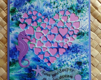 "Seahorse love card with heart in ocean background ""Love you deeper than the ocean"" v.1"
