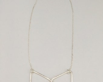 Brushed triangles bow tie necklace, sterling silver