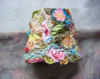 spring dream - a delicate hand embroidered collage wrist cuff in spring pastel colors
