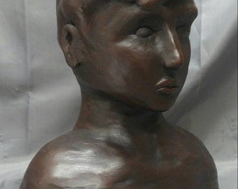 Old vintage handmade terracotta statue bust sculpture of a boy