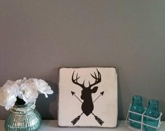 Deer head and arrow wood sign. Crossed arrow buck head sign