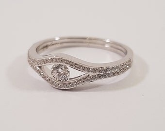 Brilliant cut diamonds in handmade white gold ring. Top quality with unique style by Cober.