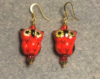 Bright red ceramic owl bead earrings adorned with red Czech glass beads.