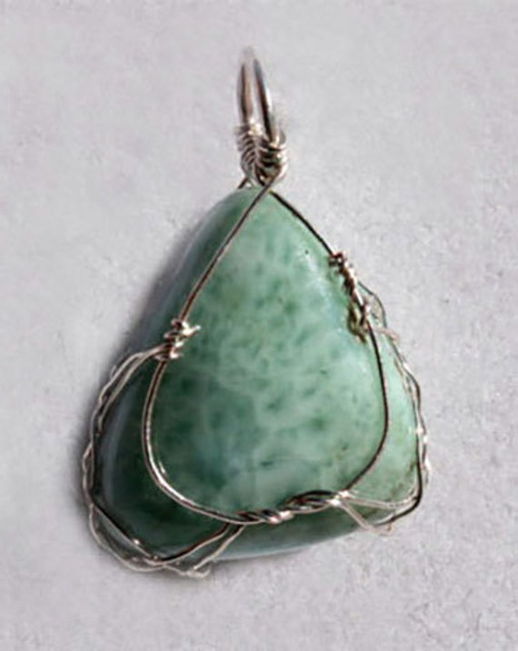 Larimar pendant wrapped Celtic style in sterling silver