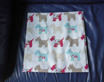 Small pet mat / pad in 'scotty dog' heavy cotton print, backed with light blue/gold furnishing cotton lightly padded for comfort/warmth