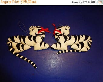272-- Pair of vintage white black strips fiber fabricated tiger's dolls w. red tie of neck
