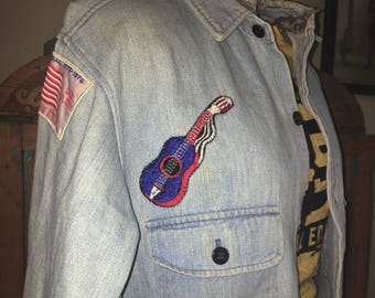 1970s denim shirt jacket with chain stitched patches.