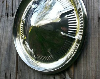 1960's hubcap, in good condition, shines nicely,men's gift, great garage, man cave or office piece. Memorabilia, collectible,
