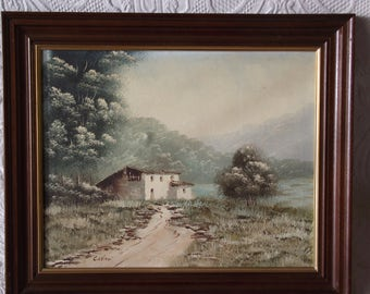 Framed oil/acrylic painting of isolated cottage in woodland setting