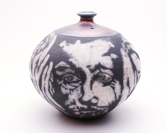 Small Faces a Raku Vase