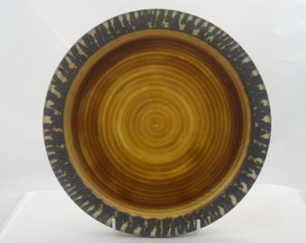 Brown plate with textured rim by Tony Bristow. Manufactred at  Bristow Pottery Chillington (post 1974).