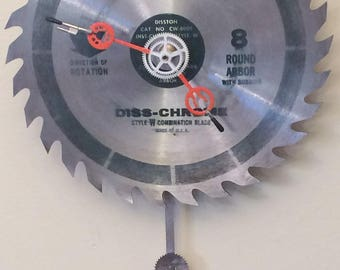Circular Saw Blade Clock with Pendulum - Conclocktion