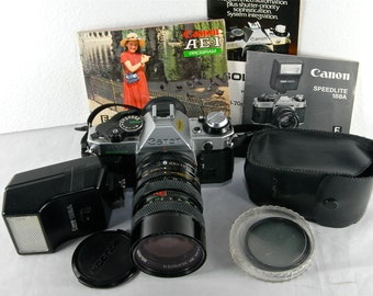 Canon AE-1 Program Film Camera with 35 to 70 f2.5/3.5 Soligor Zoom lens. Canon Speedlite 188a Flash Photography Student Art Photo Vintage