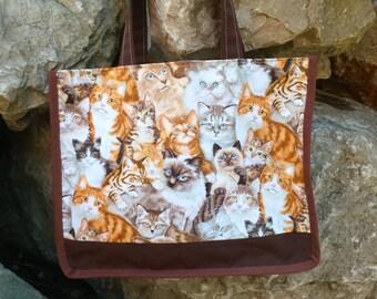small handbag with lots of cats