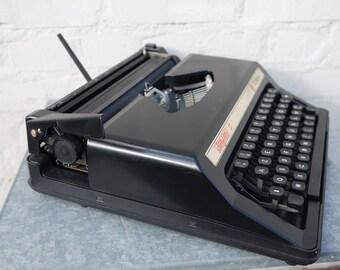 "Vintage 70' black portable Olympia ""Dactylette S"" manual typewriter"