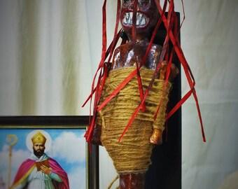 African Voodoo fetish. Redhead.