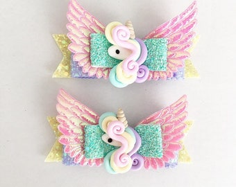 unicorn bows. glitter, felt. pastel charms. Wings. Irridecent and holographic matetials. Girls/ baby bows