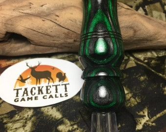 Dark grey and green laminate double reed duck call.