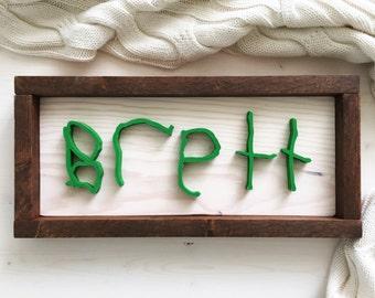 Handwritten child's name sign