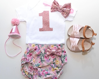 Pink floral first birthday outfit, set bodysuit,ruffle bloomer, party hat, headband,diaper cover set. I am one, shoes are not included.