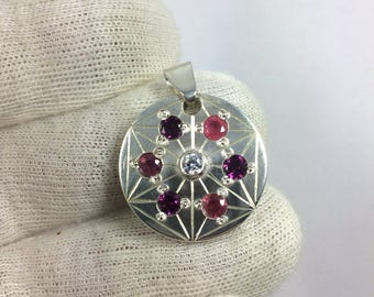 Silver sterling ruby and garnet, serious asanoha rodholite hand made pendant is hand