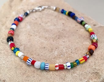 Multicolored seed bead bracelet made with African seed beads, Hill Tribe silver rondelle beads and a sterling silver lobster clasp