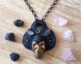 Hematite skull w/ Om Quartz afro pendant necklace