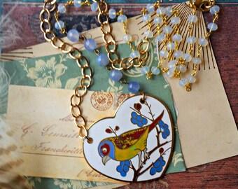 enameled bird heart necklace. big chunky asymmetrical assemblage jewelry beaded rosary chain quartz glass beads shabby chic