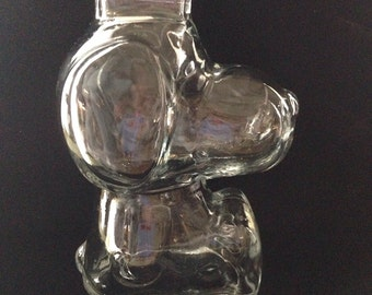 Vintage Peanuts Snoopy clear glass coin piggy bank.