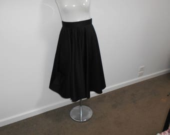 Plain 1950's inspired cotton sateen full circle skirt. Mid calf length. Black and navy available.