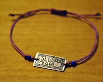 Handmade macrame bracelet with waxed thread and sterling silver!