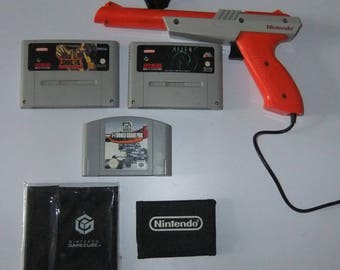 Nintendo games, wallets and NES Zapper retro collection lot