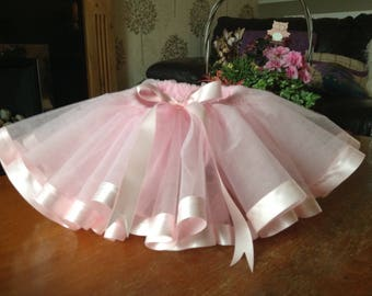 Baby tutu in tulle ribbon edged