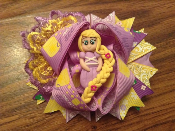 Rapunzel OTT hair bow, finished on a crocodile clip.