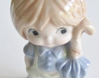 Kelvin's Boy in Blue Ceramic Figurine, Ceramic Figurines, Kelvin's Boy in Blue with Umbrella