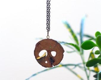 Wooden Necklace With Brass Bird