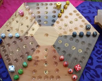 Beautiful aggravation board game is made from seven different kinds of wood and it has 6 dice and 6 sets of marbles