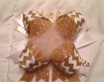 Gold glitter feather bow