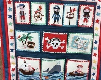 Boys pirate wall hanging with pockets for small toys