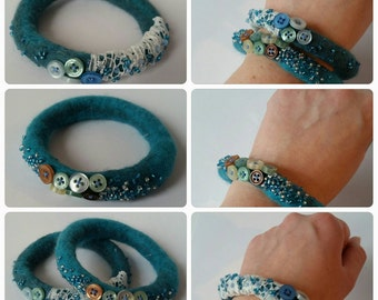 Pair of blue/teal wet felted merino bangles with beads and buttons